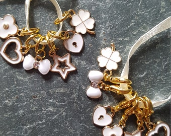 6 Knitting or crochet gold coloured  stitch markers. White enamel