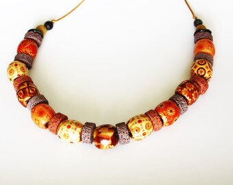 Necklace with large wooden beads and lava stones