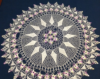 Gorgeous mid-century vintage thread crochet doily in purple, yellow, and white.