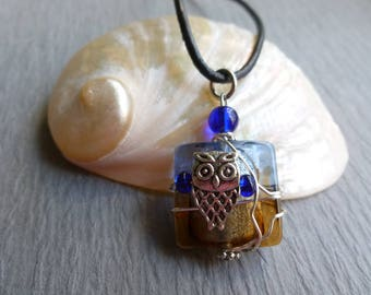 Blue and amber glass pendant with owl wire wrapped leather cord