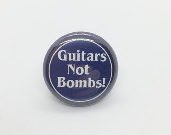 Guitars Not Bombs! - 1 inch Pin or Keychain or Zipper Pull