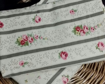 An adorable 2 pc. stripe, leafy rose, bed set,  100% cotton. One twin flat sheet and on twin size fitted sheet .