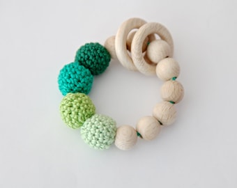 Shades of green teething ring toy with crochet wooden beads. Rattle for baby.