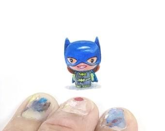 Print of miniature watercolor painting of batgirl.  giclee print of batgirl toy