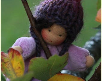 Little pocket doll waldorf inspired with woolen purse.