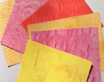 Paste paper. Hand decorated paper for all creative uses.  Reds,yellow, pink  Ref #1704