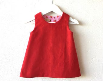 Baby girl reversible pinafore dress red and pink dress