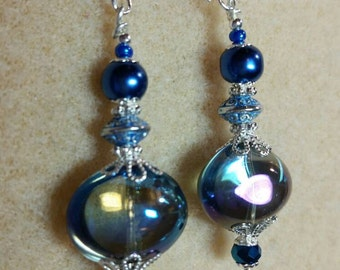 Not for the faint of heart. Statement earrings, lamp work focal in shimmering dark teal with crystal and silver