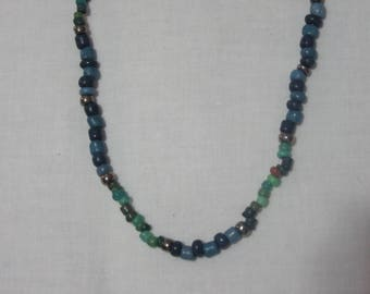 Blue, green, and aqua beaded necklace with silver accent