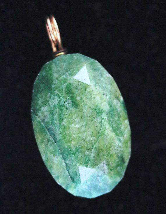 Emerald pendant, gold twirl bail 136ct
