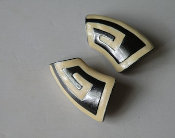 Monet off-white enamel, hematite color clip-post earrings.