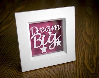 Dream Big Papercut in white frame.