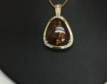 14K Yellow Gold Fire agate with white diamonds.