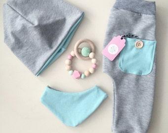 Babyset consists of beanie bib trousers