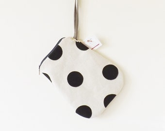 Light beige long clutch with hand-painted black polka dots