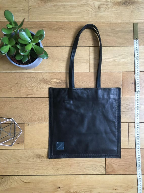 Square soft Black lambs leather fully lined bag tote with skinny leather straps zipe compartment