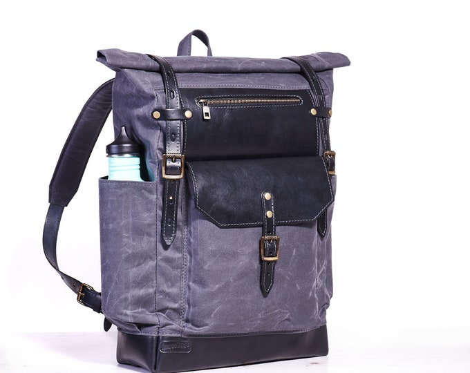 Roll top canvas backpack for 15 inch laptop.