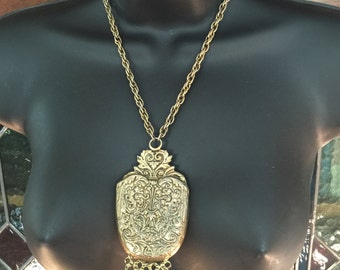 A large pendant 1960s necklace in antique goldtone metal,signed Jeanne