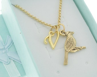 Cardinal necklace in gold pewter and personalized with a gold plated metal initial charm on a stainless steel chain.  Letter K