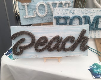 Beach nail  and string art on reclaimed timber