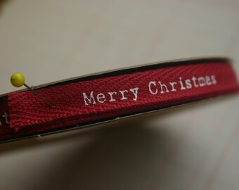 "Merry Christmas Twill Trim - Red Cotton Twill Tape with White Print - 3/8"" Wide"