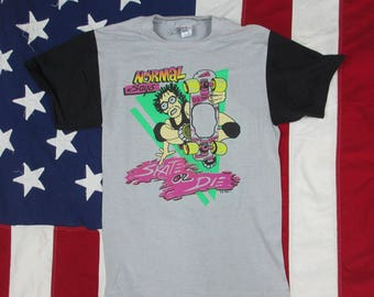 "Vintage 1980's ""Normal Says Skate or Die"" Graphic T-Shirt XS/Small Grey Black Cartoon Comic Skating Skateboard Pink Green"