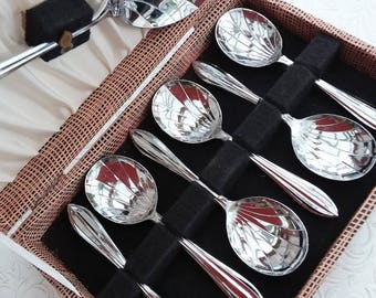 Dessert spoons, boxed, 1950s' fruit or pudding spoons and matching serving spoon, scalloped  chrome spoons.