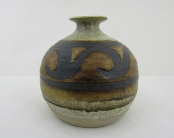 Studio pottery vase A bulbous posy vase with flared rim Stoneware flower vase with with black swirls over a brown glaze around the body