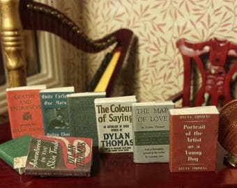 1.12 scale miniature vintage set of 8 Dylan Thomas novels with aged turnable blank pages.
