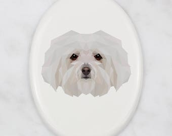 A ceramic tombstone plaque with a Bolognese dog. Art-Dog geometric dog