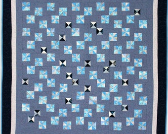 Dancing blue pinwheels throw or baby quilt