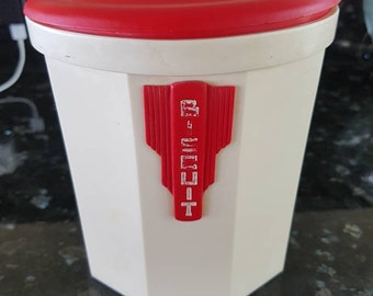 A vintage red and cream bakelite biscuit canister by Ipex
