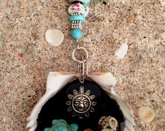 Sea shell key chain with turtle, sun and shells