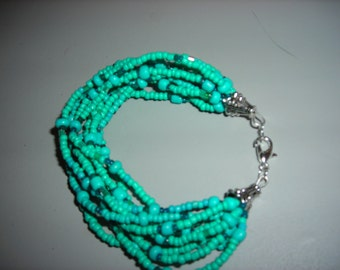 """7.5"""" Tourquoise beaded bracelet, 10 strand of beads with larger tourquoise beads mixed."""