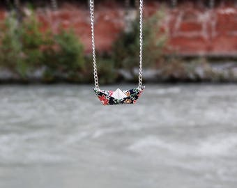 Handmade necklace with origami boat
