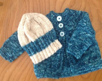 Hand knitted dark blue cardigan with hat in easy care wool