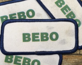 Bebo Patches. A lot of four used/dirty Bebo patches in green print with blue border