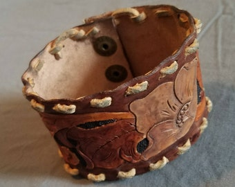 Hand tooled, hand painted floral pattern cuff on soft leather