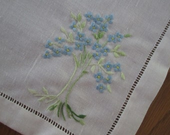 Eight white linen cotton table linens, placemats embroidered with green trees and blue flowers, Vintage
