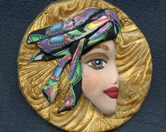 Polymer Clay  One of a kind  2 Inch Medium Face with abstract hat Cab  SLP 2