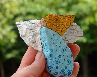 painted rock of angel