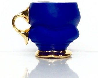 blue mug with gold one finger handle