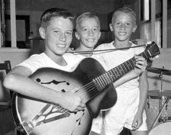 Barry, Robin, and Maurice Gibb in 1956