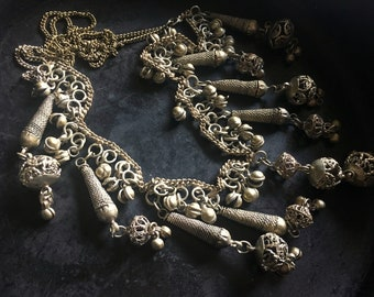 Silver washed metal filigree belly dancer necklace, long chain of jangling beads and bells. Vintage splendor!