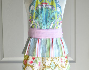 """Girls Ruffled Apron: The """"Emily"""" Apron, in pinks, greens, and blues, with three layers of ruffles and a halter bodice"""