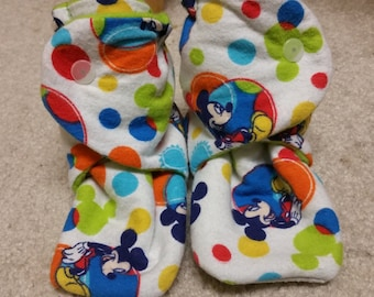 4.25 inch fit,  flannel mickey mouse booties lined with green fleece.