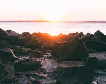 Sunset and a Rock-Covered Shore