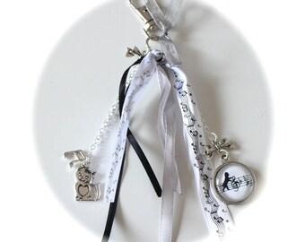 LIPIKI artwork: jewel bag cat sheet music glass charms silver ribbons satin black and white organdy music notes