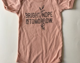 Bright Hope for Tomorrow, size 6-12 Months, Screen printed Baby one-piece, blush pink with Black print
