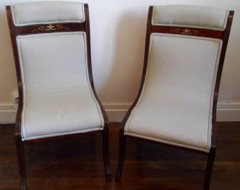 A pair of Edwardian boudoir chairs.